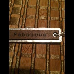 It says Fabulous- Key Chain